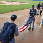 Penn State infielder Tyler Kendall, left, scrapes mud from his shoes as he and teammates Nick Hedge, center, and Jack Anderson wait in the dugout during a downpour at the Latin American Stadium in Havana, Cuba, on Sunday. The team's game against Cuba's Industriales was rescheduled to Monday because of the rain.