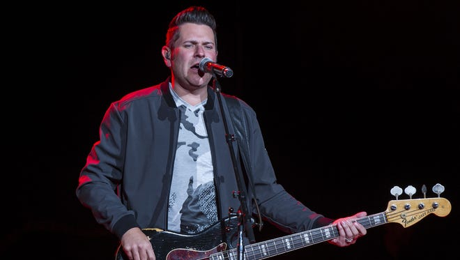Jay DeMarcus performs with Rascal Flatts at Klipsch Music Center.