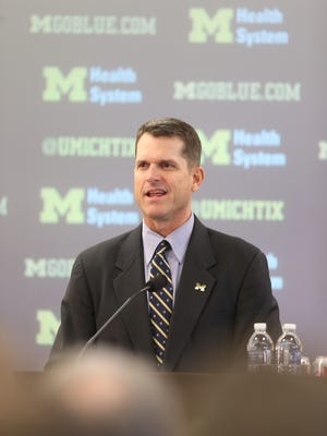 New Michigan coach Jim Harbaugh was introduced Tuesday in Ann Arbor. The Wolverines will meet him on campus this week.