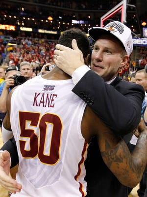 Iowa State coach Fred Hoiberg embraces sernior guard DeAndre Kane after the Cyclones won the Big 12 tournament championship on March 15, 2014, in Kansas City, Mo.