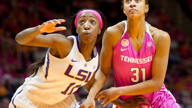 LSU's Raigyne Moncrief, left, and Tennessee's Jaime Nared eye a rebound during Thursday's game at Thompson-Boling Arena.