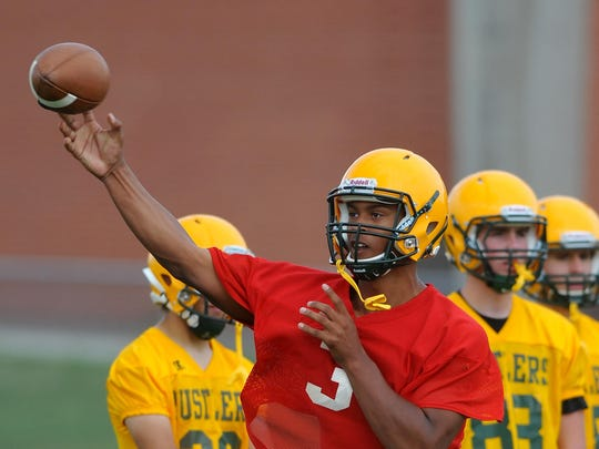 CMR quarterback Karl Tucker II throws to a receiver