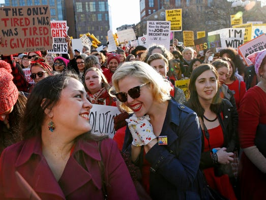 Women attend a rally at Washington Square Park, part