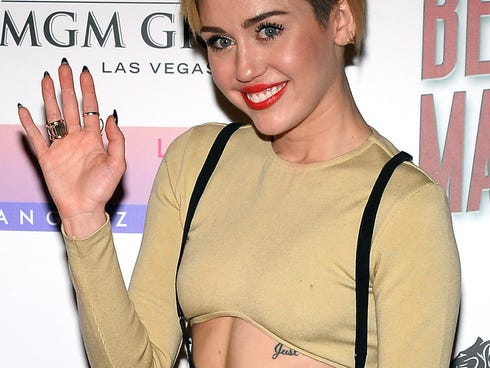 Miley Cyrus arrives at the premiere of Beacher's Madhouse Las Vegas at the MGM Grand Hotel/Casino on December 27, 2013 in Las Vegas, Nevada.