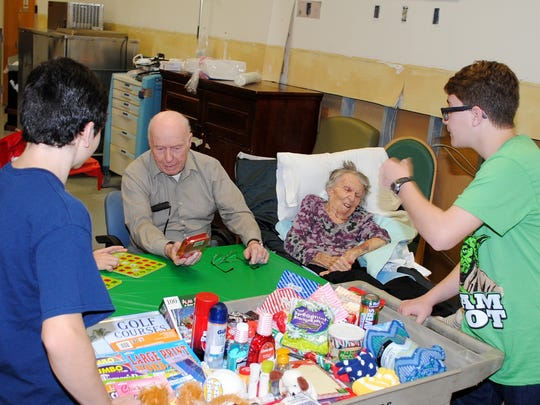 Members of the Lakeside Middle School chapter of the National Junior Honor Society play bingo with residents during a visit to the New Jersey Veterans Memorial Home in Vineland.
