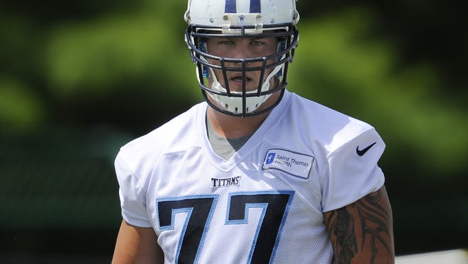 Titans tackle Taylor Lewan makes his way to the next drill during practice at Saint Thomas Sports Park on June 18.