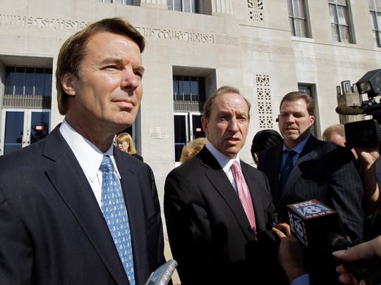 In an Oct. 27, 2011 file photo, former U.S. Sen. and presidential candidate John Edwards, left, speaks to the media with attorney Abbe Lowell, right, as he leaves the federal court in Greensboro, N.C.