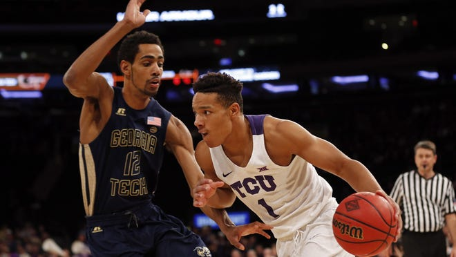 Mar 30, 2017; New York, NY, USA; TCU Horned Frogs guard Desmond Bane (1) drives to the basket past Georgia Tech Yellow Jackets forward Quinton Stephens (12) during the first half in the championship game of the 2017 NIT Tournament at Madison Square Garden. Mandatory Credit: Adam Hunger-USA TODAY Sports