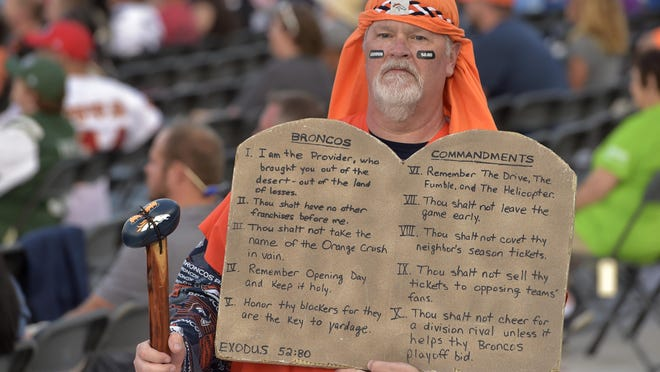 A fan holds up a sign during the induction ceremony at the Pro Football Hall of Fame, Saturday, Aug. 3, 2019, in Canton, Ohio.