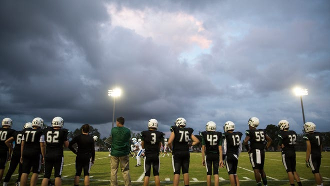 The Neumann Celtics football team stands on the sideline during their game against the Gateway Charter Griffins at St. John Neumann High School in Naples on Tuesday, Oct. 24, 2017.
