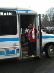 Bus buddy Phyllis Lewis helps people find their way
