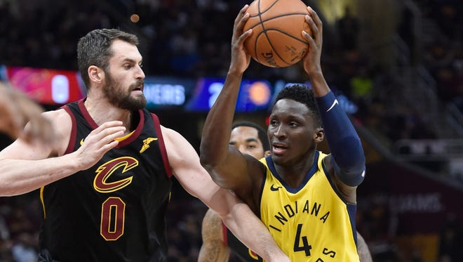 Indiana Pacers guard Victor Oladipo (4) drives against Cleveland Cavaliers center Kevin Love (0) in the first quarter in game five of the first round of the 2018 NBA Playoffs at Quicken Loans Arena.