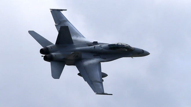 In this April 12, 2013, file photo, a U.S. Marine F/A-18 Hornet jet flies low pass during Philippines-US joint military exercise in northern Philippines.