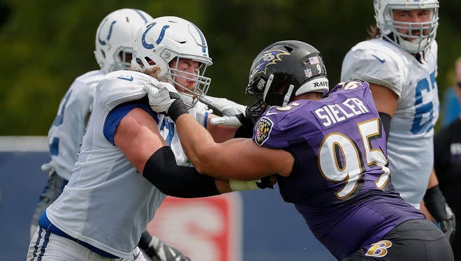 Indianapolis Colts offensive tackle Joe Haeg (73) blocks Baltimore Ravens defensive end Zach Sieler (95) during the Colts and Ravens joint practice at Grand Park in Westfield on Saturday Aug 18.