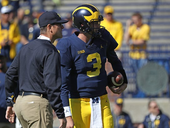 Michigan head coach Jim Harbaugh and quarterback Wilton