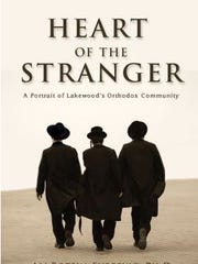 "Book cover for ""Heart of the Stranger: A Portrait of Lakewood's Orthodox Community,"" by Ali Botein-Furrevig."