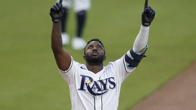 Tampa Bay Rays outfielder Randy Arozarena celebrates after hitting a two run home run against the Houston Astros during the first inning in Game 7 of the American League Championship Series on Saturday, in San Diego.