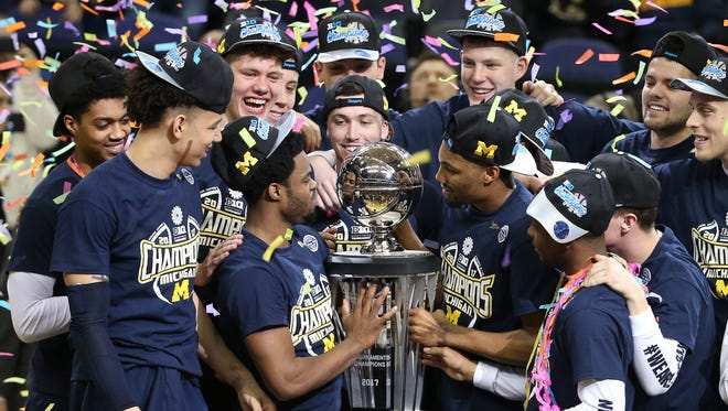 Mar 12, 2017; Washington, DC, USA; The Michigan Wolverines players hold their trophy after winning the Big Ten Conference Tournament championship game 71-56 against the Wisconsin Badgers at Verizon Center. Mandatory Credit: Amber Searls-USA TODAY Sports