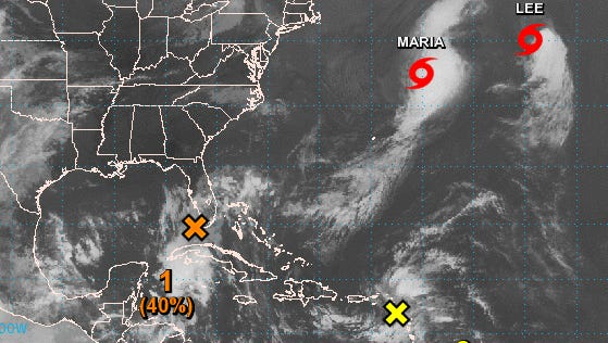 """A low-pressure system, marked with the orange """"X,"""" will bring rain and wind to Florida this weekend."""