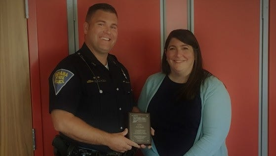 Trooper Eric Fields received a Pediatric Hero award Wednesday from   Elizabeth Weinstein, the director of Indiana Emergency Medical Services for Children.