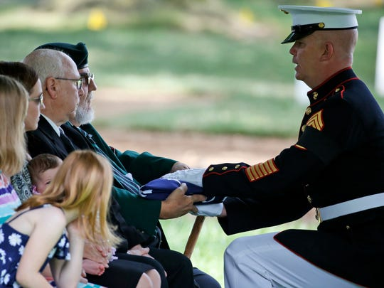James C. Johnson receives the flag from U.S. Marine Command Sgt. Major Joseph Gray during burial services for his uncle, WWII Marine Pfc. James B. Johnson of Poughkeepsie on May 31 at Arlington National Cemetery in Arlington, Virgina.
