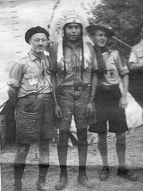 Earl Old Person, center, in 1947 at the sixth World Boy Scout Jamboree north of Paris, France. Old Person was the only Indian Boy Scout to attend the event.