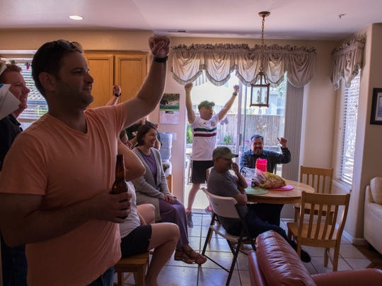 """Mexico fans in Salinas cheer on the second goal of the game, scored by Javier """"Chicharito"""" Hernández, to give Mexico a 2-0 lead."""
