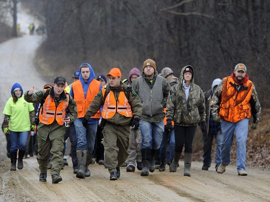 Volunteers gather to search for Jace Lyon, 9, in a