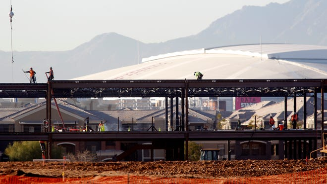 Construction workers erect steel framework for the Tohono O'odham Nation's West Valley casino southeast of Loop 101 and Northern on February 26, 2015.