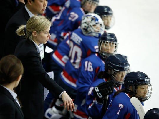 Combined Koreas head coach Sarah Murray, left, watches a women's ice hockey friendly game between her team and Sweden at Seonhak International Ice Rink in Incheon, South Korea, Sunday, Feb. 4, 2018. (Kim Hong-Ji/Pool Photo via AP)