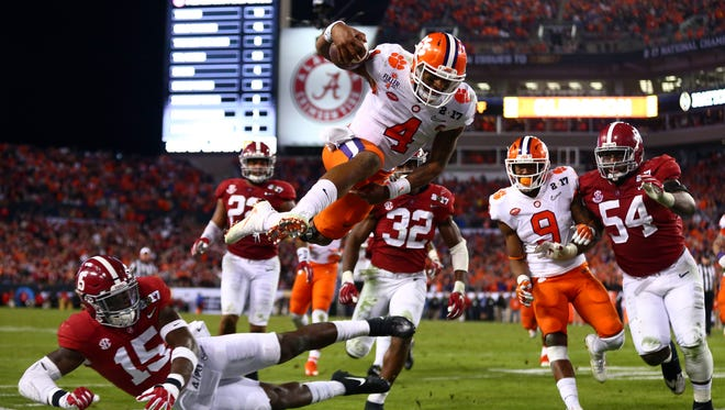 Clemson Tigers quarterback Deshaun Watson dives for the end zone during the national championship game against Alabama.