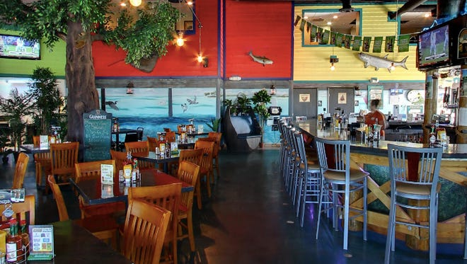 Woody's Surfside Island Rum & Grille has reopened after having been closed for three weeks.