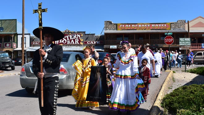 In this 2017 file photo, kicking off the day, a procession walks through Burro Avenue.