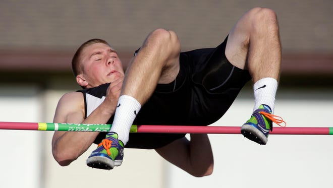 Plymouth's Samuel Staehling clears the bar in the high jump at the Division 1 Sectionals Thursday May 26, 2016 at West Bend.