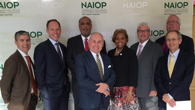 "Pictured from left to right at NAIOP NJ's recent ""Obstacles into Opportunities"" forum are President-Elect and Vice President of Public Affairs Dave Gibbons of Elberon Development Group, President Clark Machemer of Rockefeller Group, Montclair Mayor Robert Jackson, discussion leader George Sowa of Greater Trenton, Camden Mayor Dana Redd, Morristown Mayor Tim Dougherty, Woodbridge Mayor John McCormac, and NAIOP NJ CEO Mike McGuinness."