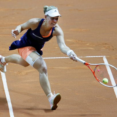 Germany's Angelique Kerber hits a forehand against
