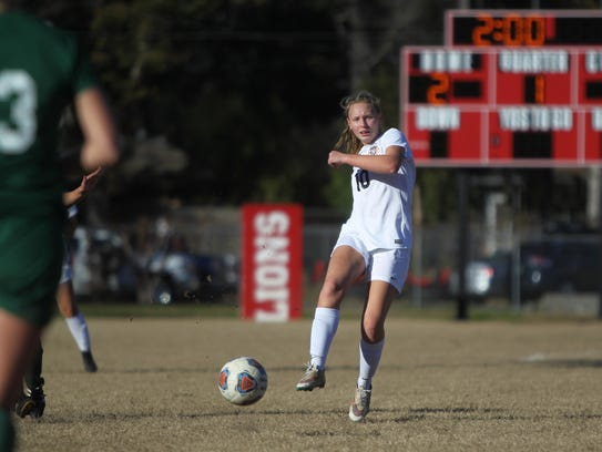 Regan Hermeling and the Leon Lions girls soccer team