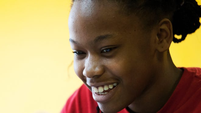 Nijaee Battle, 15, is among the students who come regularly to The Bridge Youth Center in Fort Myers.