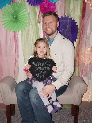 JJ Raflik and his daughter, Jillian, pose for a photo at the Father/Daughter Date Night event, where father/daughter, grandfather/granddaughter, uncle/niece, brother/sister and other various types of pairs enjoyed all the wonderful festivities of the evening.