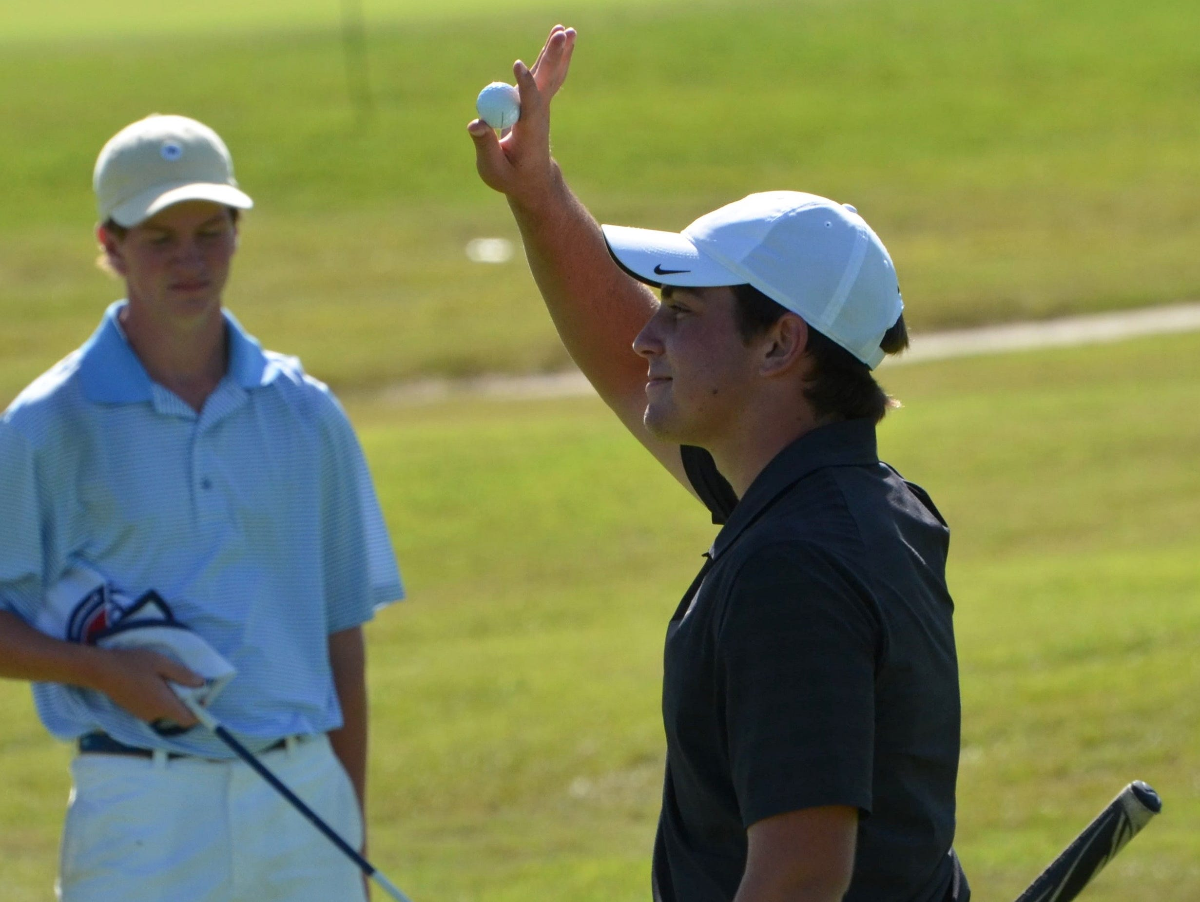 Ensworth's Brock Ochsenreiter waves to the crowd after carding a 5-under 139 for the tournament.