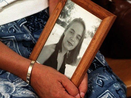 Rose Larner-mom holds photo