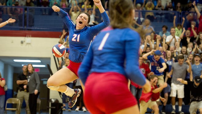 West Henderson's Sierra Jones (21) celebrates a point during a Nov. 1 match for the Falcons.