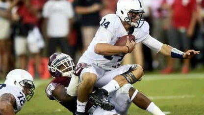 Christian Hackenberg was sacked 10 times Saturday at Temple. (Ryan Blackwell -- Public Opinion)