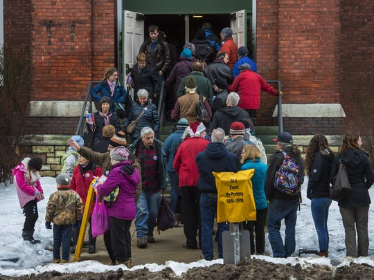 Audience members file in and out of the First Baptist Church during First Night Burlington on Thursday.