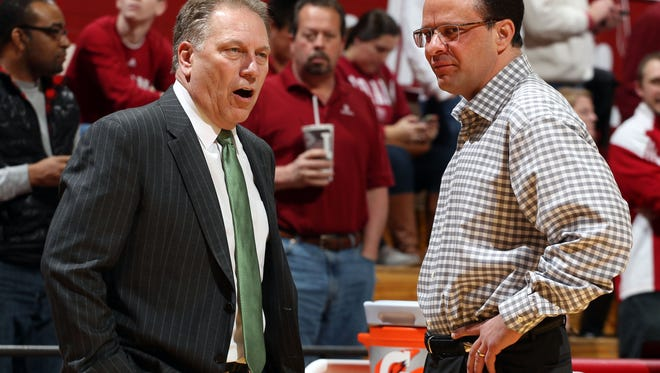 Indiana Hoosiers coach Tom Crean talks before the game with Michigan State Spartans coach Tom Izzo (left) at Assembly Hall.