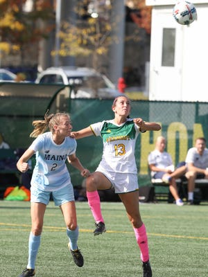 UVM's Savana Yurick wins a ball in the air over Maine's Mikayla Morin in Sunday's soccer game in Burlington. Yurick would have the game's lone goal of the day in the 1-0 Vermont victory.