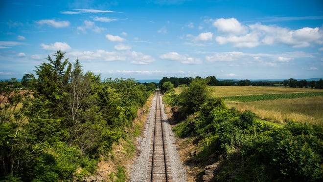 """Part of the railway that runs through the Gettysburg National Military Park near the Edward McPherson farmstead is known as the """"railroad cut."""" Basil Biggs, a free African-American resident in Gettysburg, was believed to have hid runaway slaves nearby at the McPherson farm."""