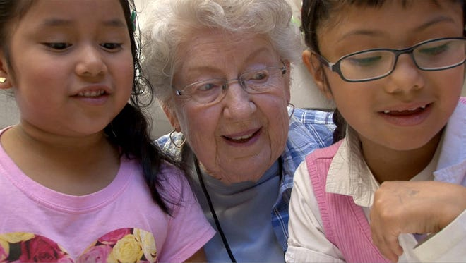Marshall W. Errickson Elementary School volunteer Virginia McGall works with kindergarten students Gredmarie Tzirin (left), 5, and Deisy Gil, 6, at the Freehold Township school Wednesday, April 5, 2017.  She is one of the volunteers from the Applewood retirement community serving as teaching aides for school.