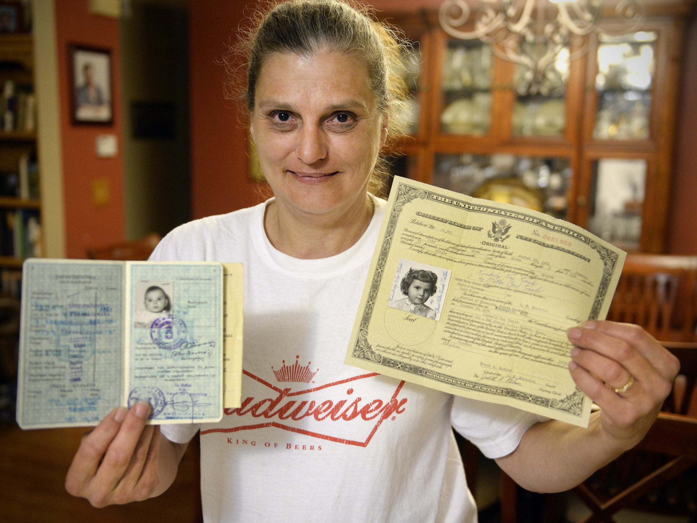 Kim Kruse has the documents adorned with her photo
