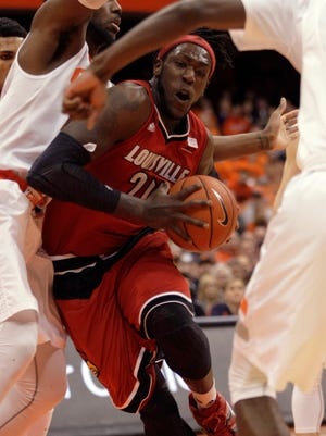 Louisville's Montrezl Harrell, right, drives to the basket against Syracuse's Rakeem Christmas, left, in the first half an NCAA college basketball game in Syracuse, N.Y., Wednesday, Feb. 18, 2015. (AP Photo/Nick Lisi)